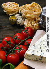Ingredients for an Italian pasta recipe on rustic wood