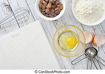 Ingredients for baking - Note book and ingredients for ...