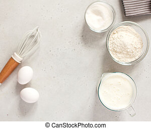 Ingredients for baking with flour and a culinary whisk with space for text, recipe. The concept of food