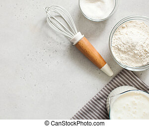 Ingredients for baking with flour and a culinary whisk with space for text, recipe. The concept of food.