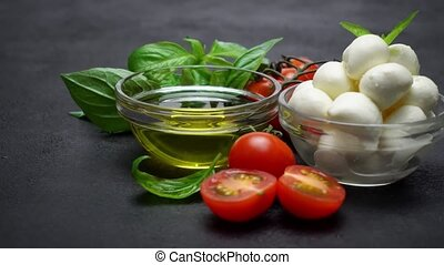 Ingredients for caprese salad - Mozzarella, tomatoes, basil...