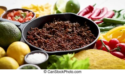 Ingredients for Chili con carne in frying iron pan on white...