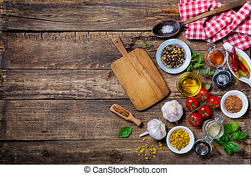 Ingredients for cooking and empty cutting board on an old ...