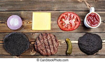 Ingredients for cooking black burger. top view - Ingredients...