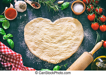 Ingredients for cooking pizza or pasta with dough in heart shape