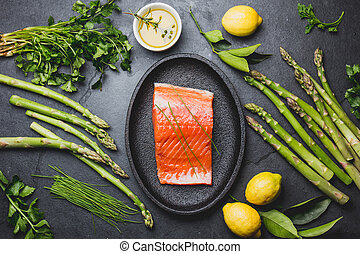 Ingredients for cooking - salmon, asparagus herbs ang lemon