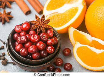 Ingredients for cooking traditional spicy winter drinks - cranberry, citrus, cinnamon, cardamom, star anise, cloves, pepper. Non-alcoholic mulled wine. Punch. The compote. Morse