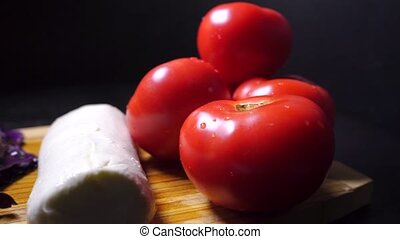 Ingredients for italian salad and female hand with a leaf of...