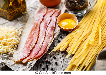Ingredients for pasta carbonara on a rustic background