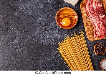 Ingredients for Pasta Carbonara on dark background.