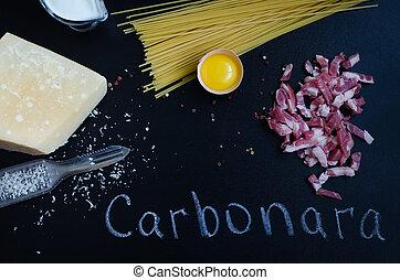 Ingredients for Pasta Carbonara on dark background