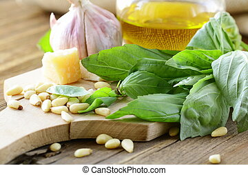 ingredients for pesto, basil, olive oil, pine nuts, garlic...