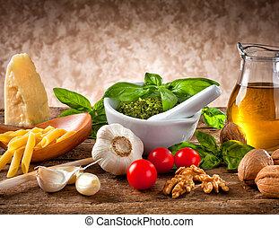 Italian pesto ingredients on wooden table