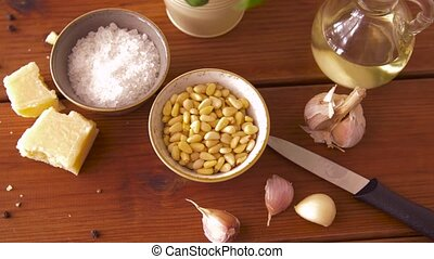 ingredients for pesto sauce on wooden table - food and...