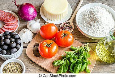 Ingredients for pizza on the wooden background