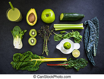 ingredients for smoothie, flat lay overhead on dark slate background