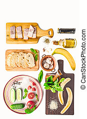 Ingredients for tartines on the white background vertical