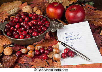 Shopping list with thanksgiving ingredients, cranberries and apples