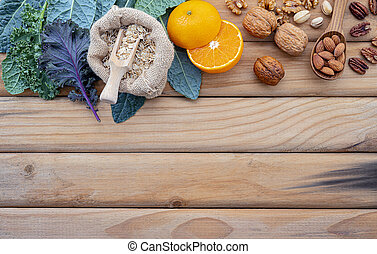 Ingredients for the healthy foods selection. The concept of healthy food set up on shabby wooden background.