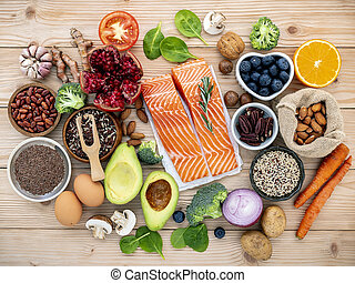 Ingredients for the healthy foods selection. The concept of healthy food set up on wooden background.