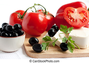 ingredients for the salad - tomato, cheese, olives.