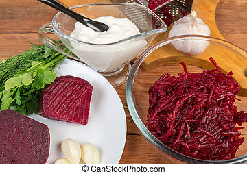 Ingredients for vegetable red beetroot salad on table close-up