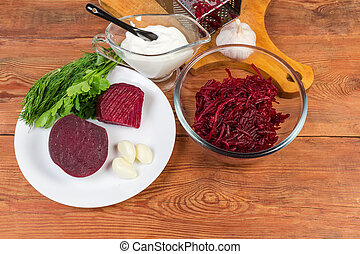 Ingredients for vegetable red beetroot salad on the rustic table