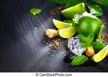 Ingredients of Mojito. Lime, mint, ice cubes and brown sugar