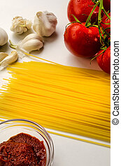 ingredients to make a delicious organic tomato sauce with spaghetti