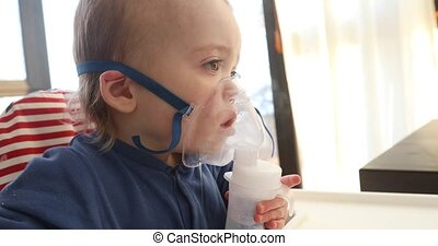 Inhalation child 1,5 year nebulizer mask vapor. The weakened...