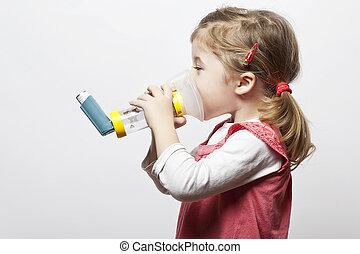 inhalation - little girl doing inhlation using her inhaler