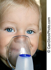 Inhalation therapy - Little, blond-hair, asthmatic boy...