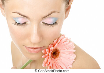 Inhaling flower aroma - Portrait of the beautiful woman...