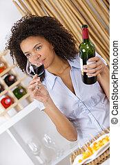 inhaling the wine's aroma
