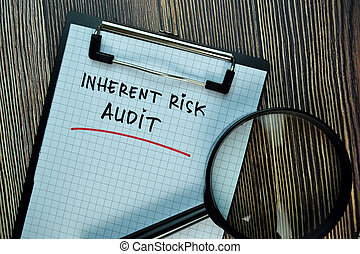 Inherent Risk Audit write on a paperwork isolated on Wooden Table. Business or Financial Concept
