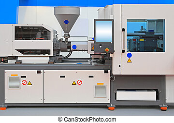 Injection molding machine for thermo plastic polymers