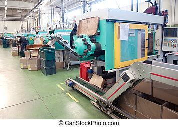 Injection molding machines in a large factory - Department...