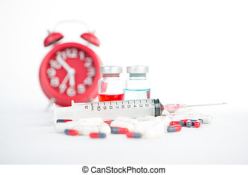Injection syringe and medicine on red clock background