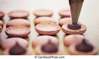 injector squeezing filling to macarons - cooking, food and...
