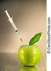injektionsspruta, närbild, grönt äpple