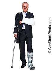 Injred businessman on crutches isolated on white - Photo of...