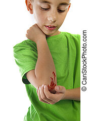 injured - a young boy with a painful elbow on white