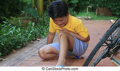 Injured boy crying