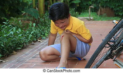 Injured boy crying