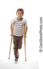 injured boy on crutches