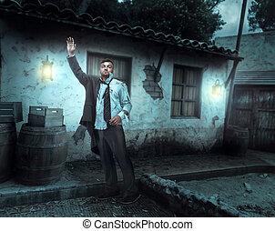 Injured businessman near an old house