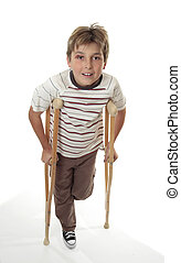 Injured child using crutches - An injured child with...