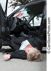 Injured driver - An injured driver with a severe head wound,...