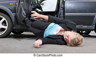 Injured driver with a laceration in her forehead, dropping...