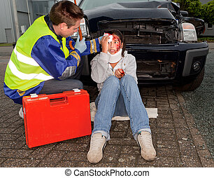 Injured in a car accident - Paramedic caring for an injured...